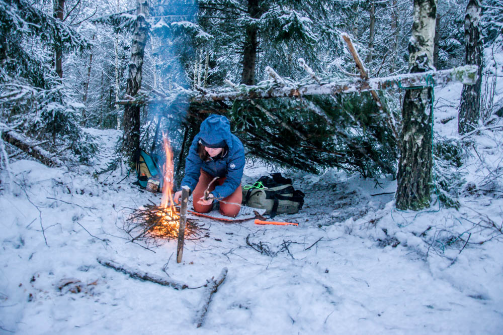winter camping in self-made shelter